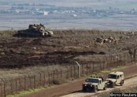 A tank stands in position close to the ceasefire line between Israel and Syria on the Israeli-occupied Golan Heights